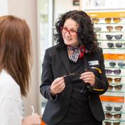 Vision Express staff helping customer