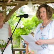 Guest speaking during ceremony of wedding at Gants Mill