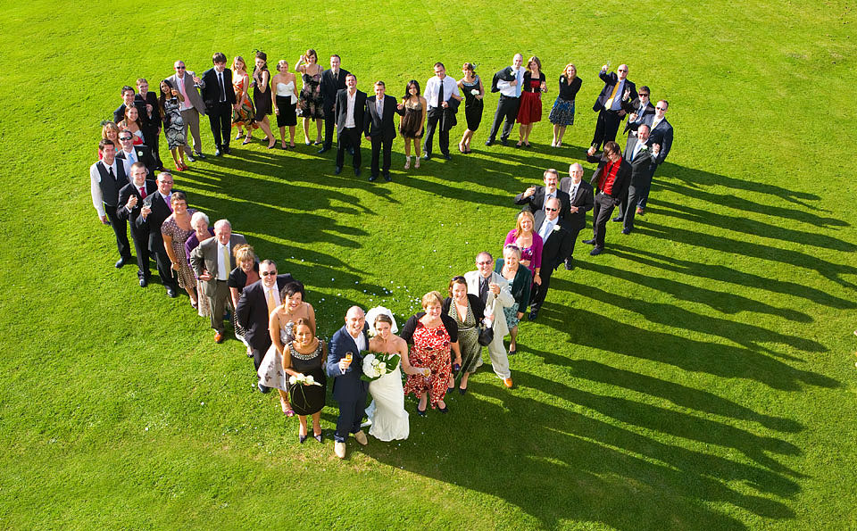 Heart shaped group photo of wedding guests