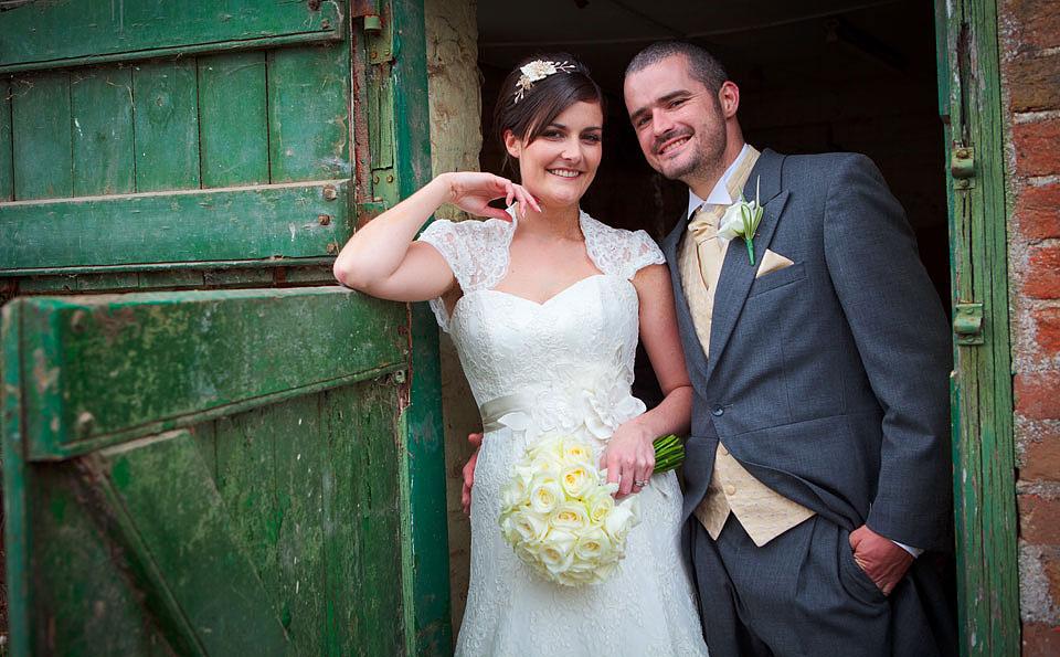 Bride and groom by an old farm gate