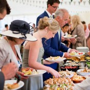 Guests selecting food from a buffet at Gants Mill