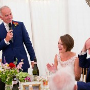 A bride laughs at her father