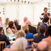 A guest makes her speech at her friends wedding at Gants Mill