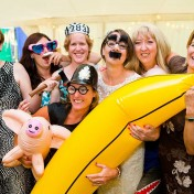 Bride and her guests dress up in crazy costume accessories including an inflatable banana