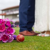 Couple standing by bouquet at Somerset County Cricket Ground