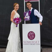 wedded couple with cricket score card at Somerset County Cricket Ground