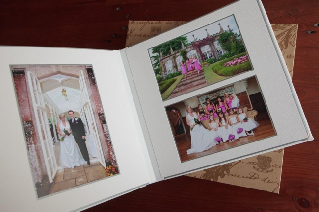 White leather wedding album made by Queensberry