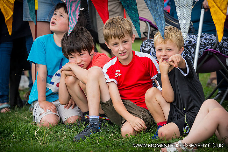 Young boys watching the ferret racing at The Lowland Games 2016
