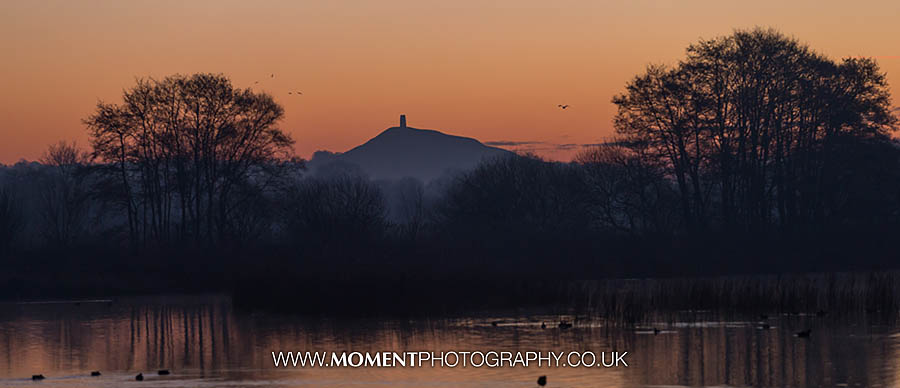 Orange sky over Glastonbury Tor