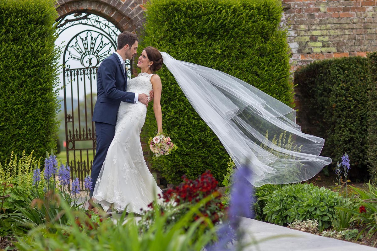 Bride and groom in the gardens of North Cadbury Court in Yeovil