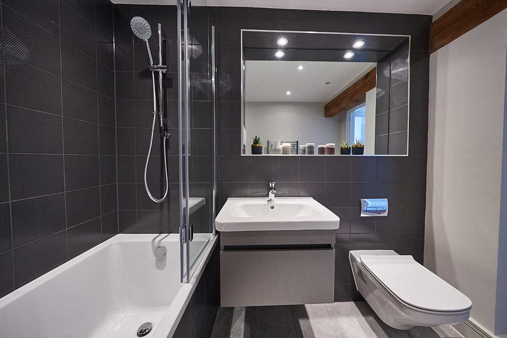 Grey tiled luxurious modern bathroom