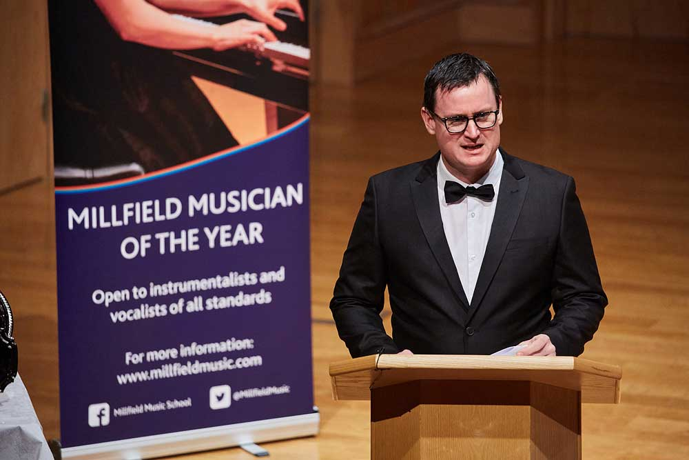 A judge speaks at Millfield School at den musician of the year competition