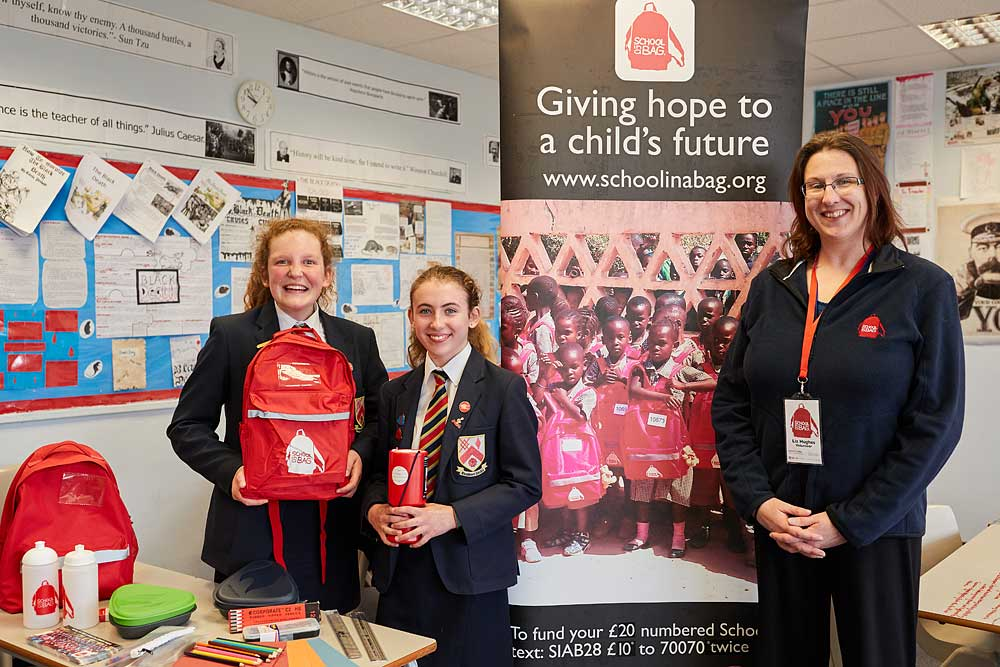 Two female pupils and the teacher at Preston School helping with a charitable cause