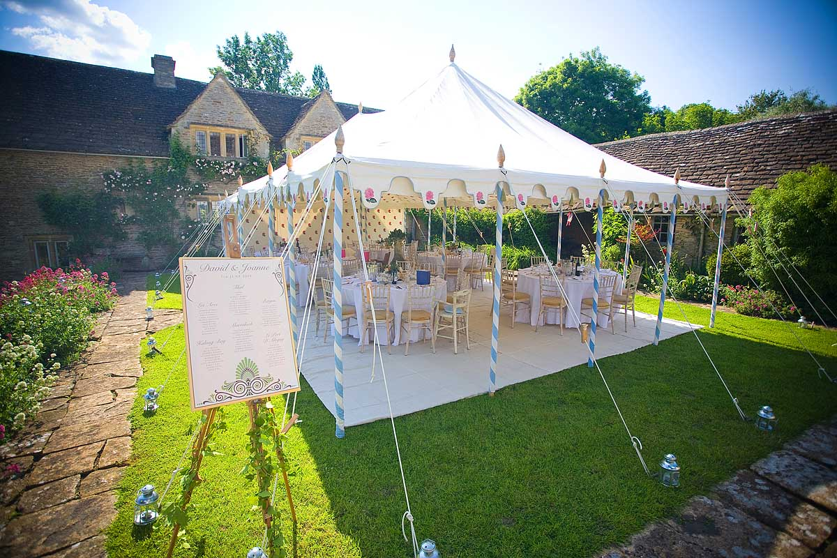 An Indian style wedding marquee in the sunshine at Sheldon Manor in Chippenham