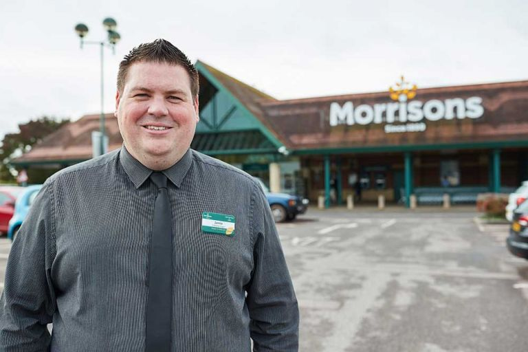 Corporate portrait of Morrisons supermarket manager outside the Bridgwater store