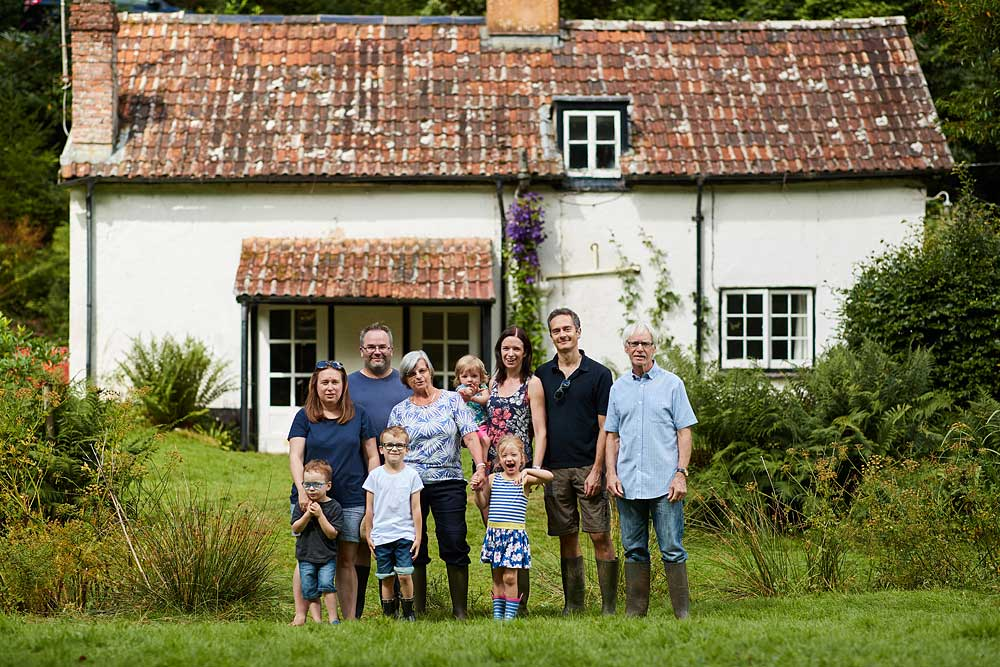 A family stood outside a rustic cottage in Dulverton on Exmoor